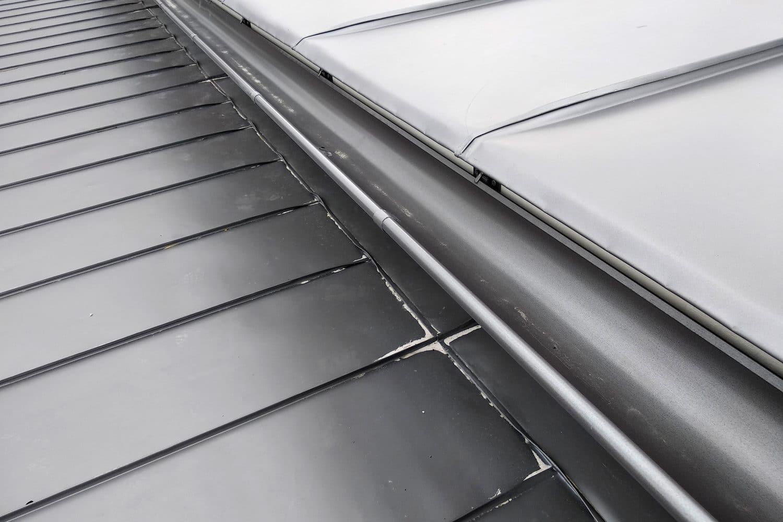 Grey metal sheet roofing
