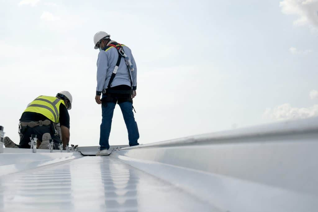 Construction engineer inspecting roof